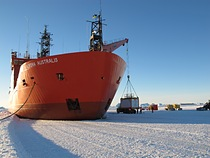 Unloading of the mobile LIDAR onto the fast ice in front of the Australian Antarctic station Davis (69° S) from the ice breaker \