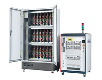 Control cabinet (left) with numerous high-voltage loads in combination with a dSPACE SCALEXIO  hardware-in-the-Loop (HIL) simulator (right).