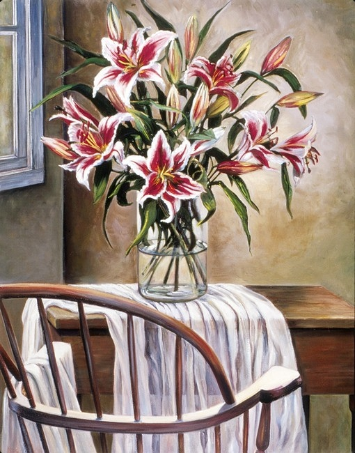A still life painting of a vase, full of lilies, atop a small wooden desk, with an old wooden chair in the foreground.