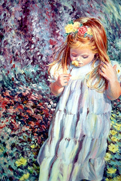 A young girl smells a flower in a garden.
