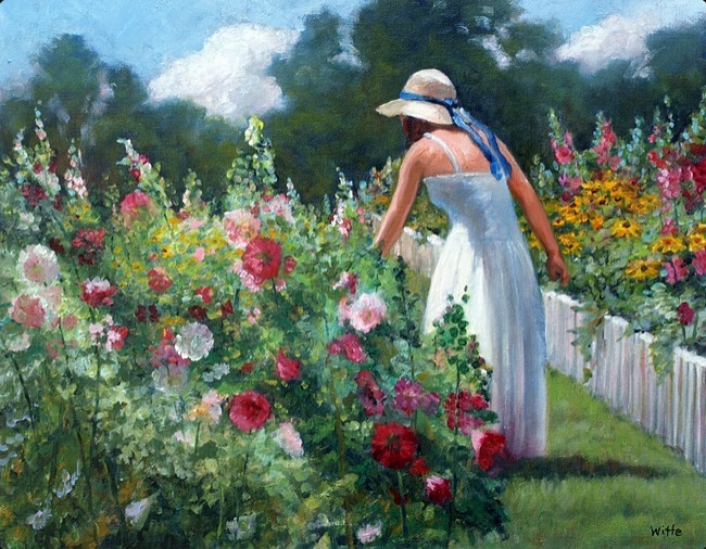 A woman in a white dress walks through a flower garden in New England.