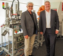 Wibu-Systems' CodeMeter technology provides strong security for the key finder prototype production line at SmartFactoryKL, presented by Prof. Dr. Detlef Zühlke, CEO of Technologie-Initiative SmartFactory KL e.V., and Director of the Research Department Innovative Factory Systems at DFKI, and Oliver Winzenried, CEO and co-founder of Wibu-Systems.
